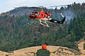 A fire helicopter with helicopter bucket.jpg
