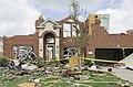 A tornado damaged home in Forney, Texas.jpg