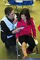 A young resident of Juneau, Alaska, right, reads her script prior to playing an injured citizen seeking assistance at an Alaska National Guard medical team field hospital at the Palmer Fairgrounds in Palmer 140328-Z-OB094-074.jpg