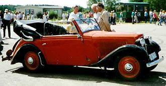 Kidnapping, Caucasian Style - The trio arrive in a red Adler Trumpf Junior similar to the one pictured.