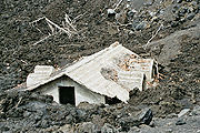House destroyed by lava on the slopes of Etna.