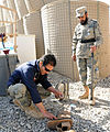 Afghan Border Police 1st Lt. Azim Noori, left, and 2nd Sgt. Abdul Khan, both explosive ordinance disposal technicians, conduct improvised explosive device disposal training with U.S. Air Force bomb technicians 130206-A-MX357-108.jpg