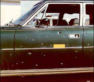 Shootout - An FBI agent's bullet-riddled car after the 1975 Pine Ridge shootout.