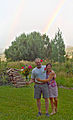 Alan L. Davis out standing in his field with Julie.jpg