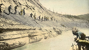 Athabasca oil sands - Athabasca oil sands on the banks of the river, c. 1900