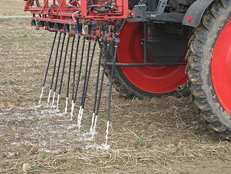 Reuse of excreta - Application of urine on a field near Bonn, Germany, by means of flexible hose close to the soil