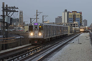 Purple Line (CTA) - A Loop-bound Purple Line train of 5000-series cars passes Bryn Mawr Avenue.