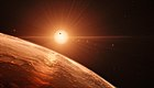 Artist's impression of the TRAPPIST-1 planetary system.jpg