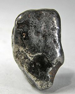 Awaruite is a nickel-iron alloy-bearing rock occuring as detritus in streams. This pebble/nugget weighs 13 grams.