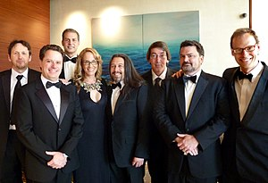 John Romero - Romero and other game developers at a BAFTA event in Los Angeles in July 2011. From left: Rod Humble, Louis Castle, David Perry, Brenda Romero, John Romero, Will Wright, Tim Schafer, Chris Hecker.