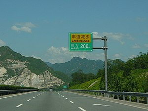 "Badaling Expressway - The Badaling Expressway gets into ""climbing gear"" as it approaches the hilly terrain near Badaling. (July 2004 image)"