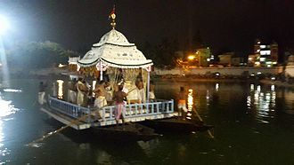 Chandan Yatra - Decorated boat of the deities in Narendra tirtha