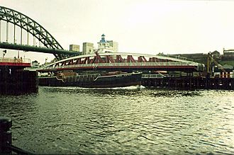 Stella power stations - Ash from the stations was carried out to sea and dumped by hopper barges. Bessie Surtees passes the Swing Bridge on a return to the Stella power stations in the late 1980s