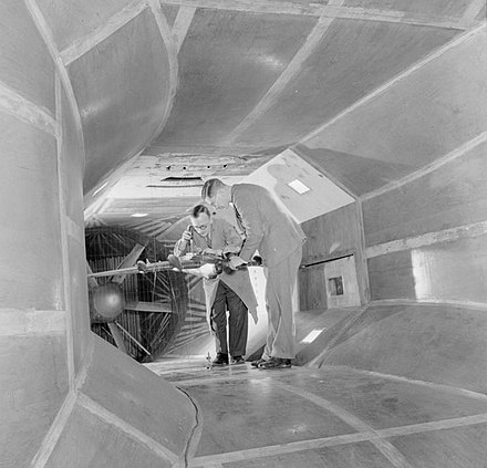 Engineers during World War Two test a model of a Halifax bomber in a wind tunnel,  an invention that dates back to 1871.