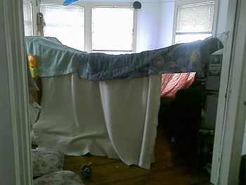 English: A blanket fort suspended on strings.