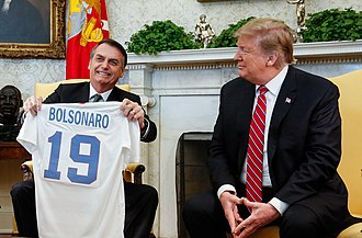 "Brazilian President Jair Bolsonaro, sometimes called the ""Tropical Trump"", with United States President Donald Trump Bolsonaro with US President Donald Trump in White House, 19 March 2019.jpg"