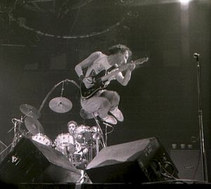 Guitar showmanship - Pete Townshend from The Who leaping in the air - an example of guitar showmanship