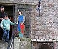 Bours (19 sept 2010) visiteurs sortant du donjon 05.jpg