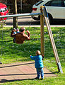 Boy Pushing Man on swing.jpg