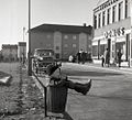 Boy resting in trash can in Gothenburg 1961 (7294089286).jpg