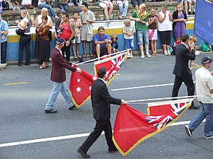 Red Ensign - The British Red Ensign being paraded alongside the Australian Red Ensign during the 2007 Anzac Day celebrations in Brisbane, Australia.