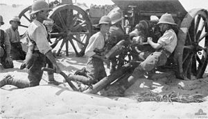 West Riding Royal Horse Artillery - British artillerymen loading an 18 pounder gun at Romani in 1916