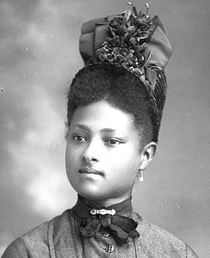 English: Dapper young African-American woman w...