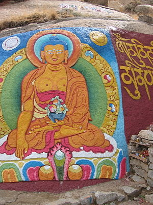 Blue hair - Buddha painted on a rock wall in Tibet