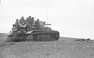 Battle of the Kerch Peninsula - German Panzer IV tank and infantry in battle on the Kerch Peninsula in May 1942.