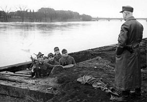 Volkssturmgewehr - Volkssturm soldiers in an emplacement along the Oder river in 1945. The soldier on the left is carrying a Gustloff Volkssturmgewehr.