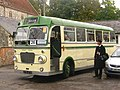 Bus Conductor with a Classic Bus.jpg