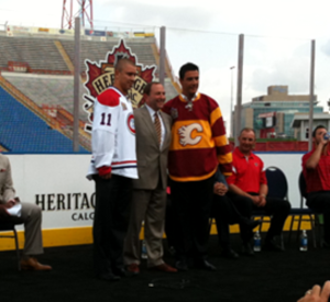 2011 Heritage Classic - Josh Gorges, Gary Bettman and Steve Staios unveil the uniforms at a press conference announcing the game.