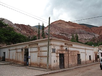 Purmamarca - Street in Purmamarca with the Cerro de Siete Colores in the background.