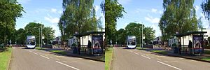 King's Hedges - The Jenny Wren pub and bus stop with an approaching Citi 1 bus.