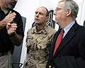 Canadian Maj. Gen. Ward and U.S. Senator Mitch McConnell talk with a police trainer advisor during a tour (4278169245).jpg