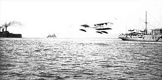Voisin Canard - La Foudre with one of her Voisin Canard seaplanes during tactical exercises in June 1912.