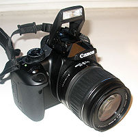 Canon EOS 400D front view with kit lens EF-S 1...