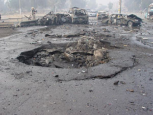 The result of a car bombing in Baghdad, Iraq
