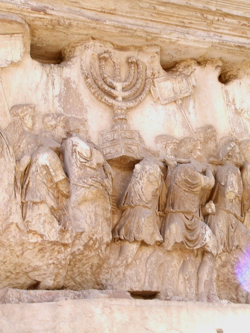 Carrying off the Menorah from the Temple in Jerusalem depicted on a frieze on the Arch of Titus in the Forum Romanum
