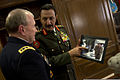 Chairman of the Joint Chiefs U.S. Army Gen. Martin E. Dempsey, left, is shown a photo of the dignified transfer of a Jordanian soldier by U.S. Service members by Jordanian Armed Forces Chief of Defense Gen 130814-D-VO565-017.jpg