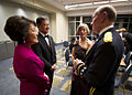 Chairman of the Joint Chiefs of Staff U.S. Army Gen. Martin E. Dempsey, right, and his wife, Deanie, second from right, discuss the evening's events with Patricia Shinseki, left, the wife of the Secretary 130121-A-TT930-002.jpg