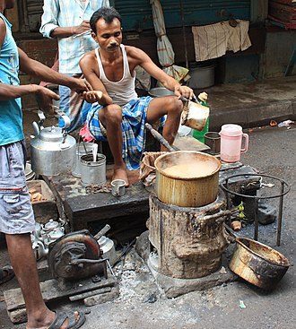 Chaiwala - A chaiwala prepares masala chai on a coal fire in a street of Kolkata.