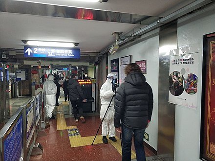Body temperature screening at the entrance of the Beijing Subway Check for 2019-nCoV in Beijing railway station metro station.jpg
