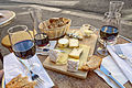 Cheese, wine and bread in a sidewalk cafe in Paris, June 2015.jpg