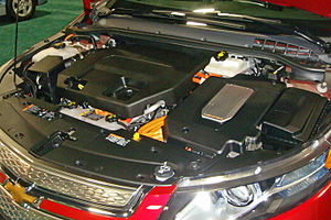 Chevrolet Volt - Right side: power inverter on top of the electric motor used for traction; left side: the 1.4 L gasoline engine used as a generator to keep the battery at minimum charge.