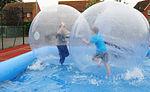 Children enjoy 'zorbing' at youth center 120702-F-EJ686-055.jpg