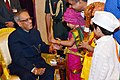 Children tying 'Rakhi' to the President, Shri Pranab Mukherjee, on the occasion of 'Raksha Bandhan', in New Delhi on August 20, 2013.jpg