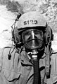 Close-up view of an AMTRAC (LVTP-7) gunner wearing his helmet and gas mask. He is taking part in Operation Gallant Eagle '82 - DPLA - ac6c73d52fd2f591ce79c400a2fea6af.jpeg