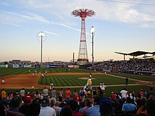 The baseball field inside the MCU Park baseball stadium. The Parachute Jump is behind the stadium.