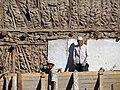 Construction Workers against Mud-and-Timber Facade - Tashkent - Uzbekistan (7466985120).jpg